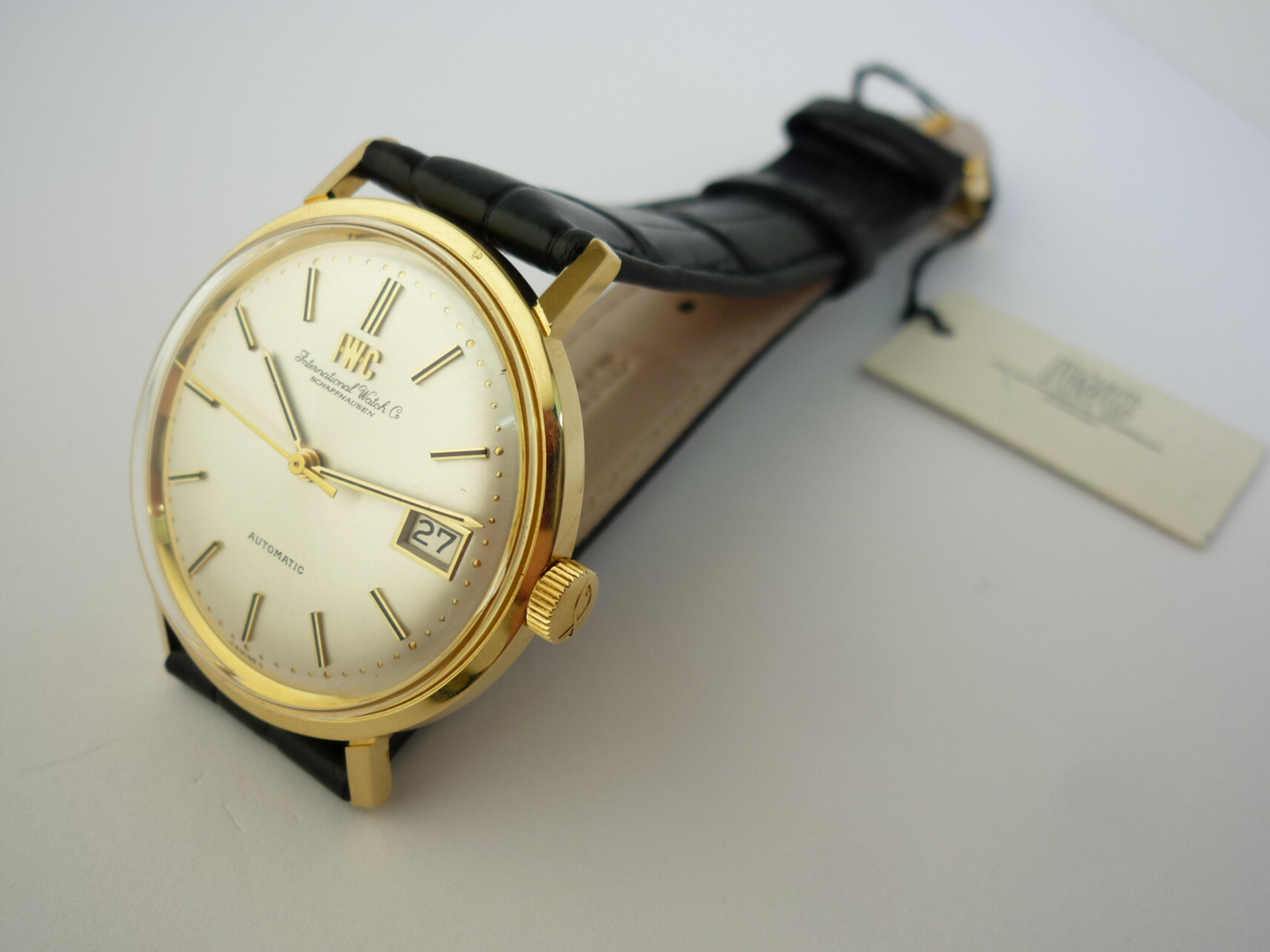 IWC 18ct solid gold watch with papers (1973)